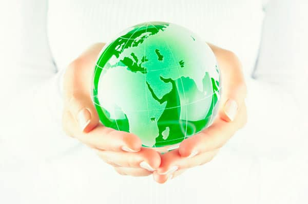 Hands surrounding a small globe